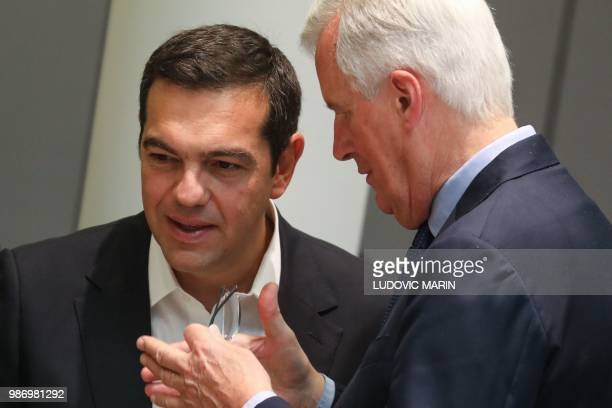 Brexit Chief Negotiator Michel Barnier speaks with Greece's Prime Minister Alexis Tsipras during the last day of the European Union leaders' summit,...