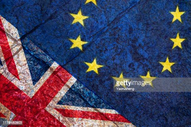 brexit, flags of the united kingdom and the european union on cracked background - brexit stock pictures, royalty-free photos & images