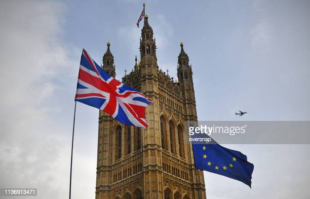 brexit flags outside parliament - brexit stock pictures, royalty-free photos & images