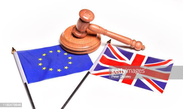 brexit issues, eu and union jack flags in conflict, with legal gavel - european union stock pictures, royalty-free photos & images