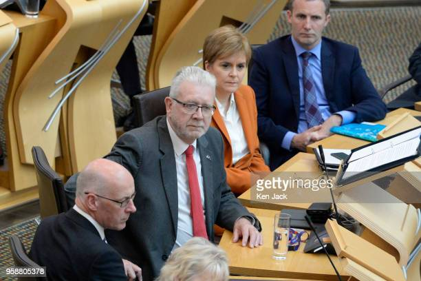 Brexit Minister Michael Russell sits alongside First Minister Nicola Sturgeon during a debate in the Scottish Parliament which is expected to refuse...