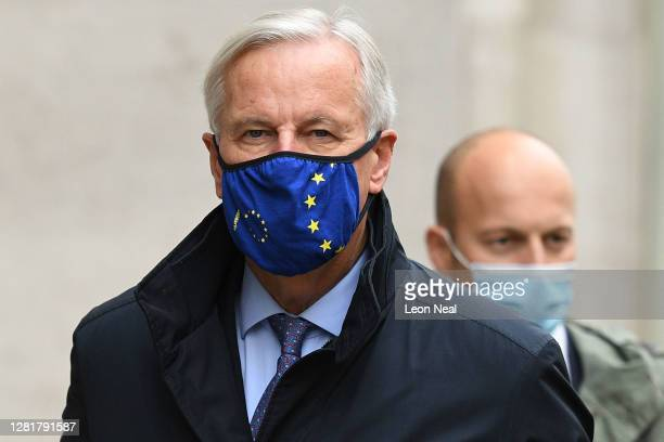 Brexit negotiator Michel Barnier walks with members of the EU delegation to the Department for Business Energy and Industrial strategy in St James on...