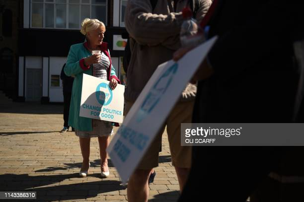 Brexit Party activists hold placards during a visit by Party leader Nigel Farage campaigning for the European Parliament election in Pontefract...
