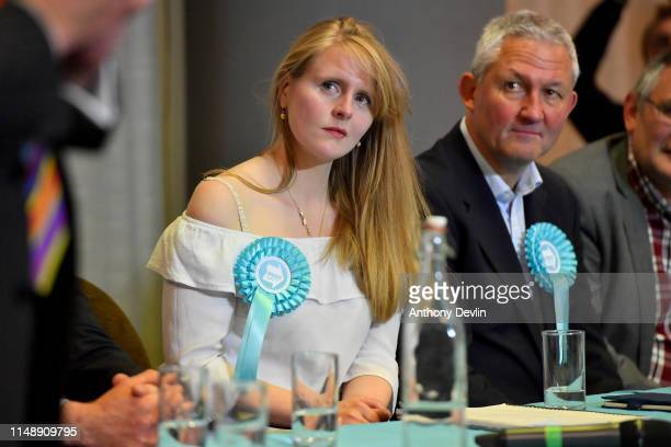 Brexit Party candidate Lucy Harris lookson as Nigel Farage speaks during a Brexit Party rally at the John Smith's Stadium on May 13 2019 in...