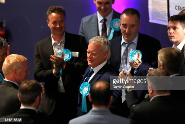 Brexit Party candidate Mike Greene is applauded by supporters as he arrives at the byelection count centre on June 07 2019 in Peterborough England...