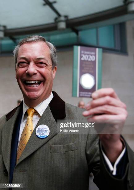 Brexit Party leader and former MEP, Nigel Farage holds up commemorative 50p coin as he arrives to appear on the Andrew Marr Show at BBC Television...