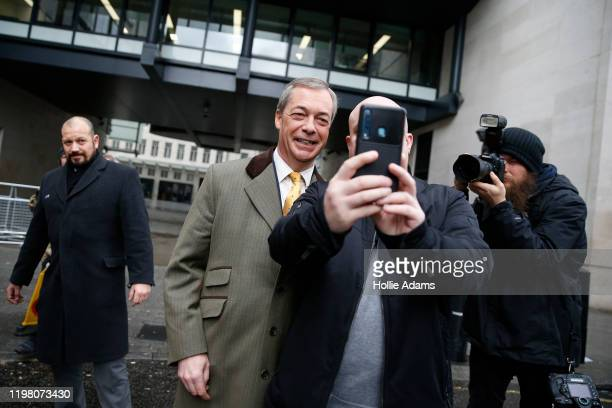 Brexit Party leader and former MEP, Nigel Farage takes a selfie with a supporter after appearing on the Andrew Marr Show at BBC Television Centre on...