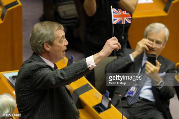 Brexit Party leader and member of the European Parliament Nigel Farage waves a British flag while speaking at a session of the European Parliament in...