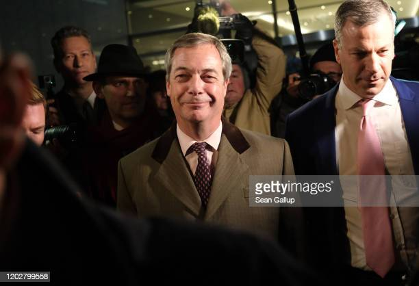 Brexit Party leader and member of the European Parliament Nigel Farage departs following a historic vote for the Brexit agreement at a session of the...