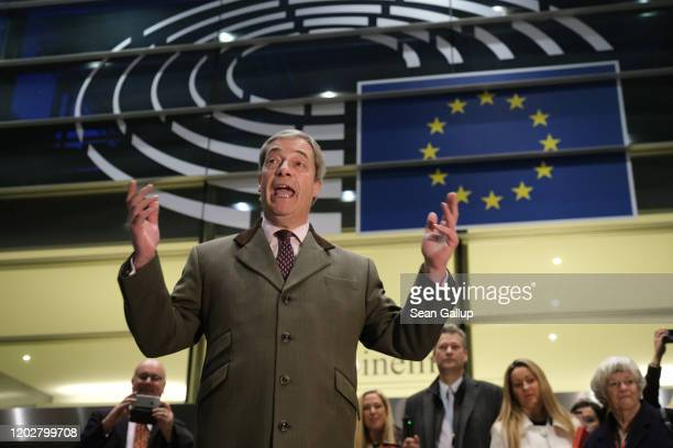 Brexit Party leader and member of the European Parliament Nigel Farage speaks to the media as he departs following a historic vote for the Brexit...