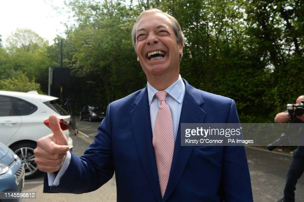 Brexit Party leader Nigel Farage arrives to cast his vote for the European Parliament elections at a polling station at the Cudham Church of England...