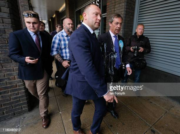Brexit Party leader Nigel Farage has what is thought to have been a milkshake thrown over him as he visits Northumberland Street in Newcastle Upon...