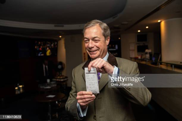 Brexit Party leader Nigel Farage holds a betting slip after placing a £1000 bet on his party to win the most seats during the UK European elections...