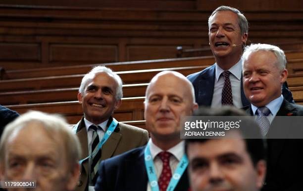 Brexit Party leader Nigel Farage listens from the back of the auditorium before speaking at an event to introduce their Prospective Parliamentary...
