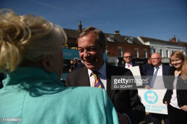 Brexit Party leader Nigel Farage meets members of the public during a 'walkabout' campaigning for the European Parliament election in Pontefract...