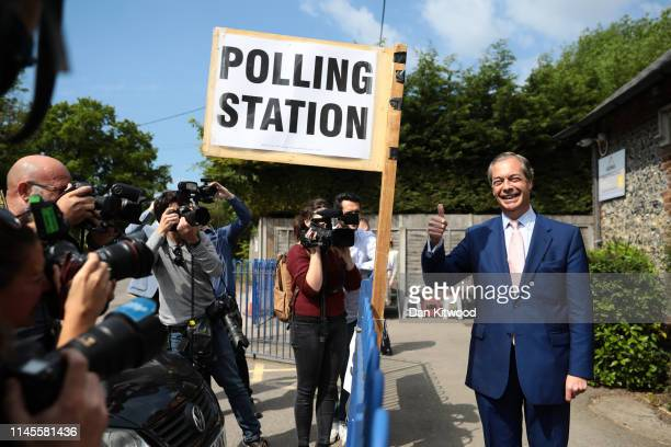 Brexit Party leader Nigel Farage poses for photographers as he arrives to vote in the European Elections at a polling station on May 23 2019 in...