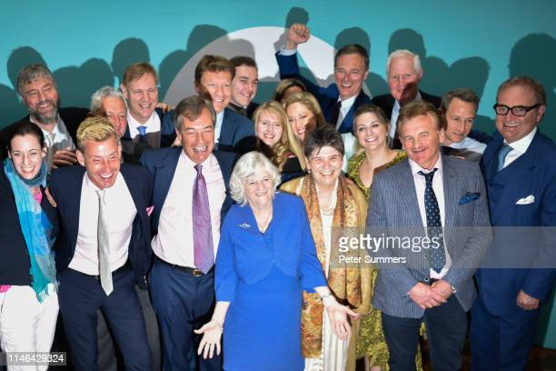 Brexit Party leader Nigel Farage poses with newly elected Brexit Party MEPs including Annunziata ReesMogg Dr David Bull and Ann Widdecombe at a...