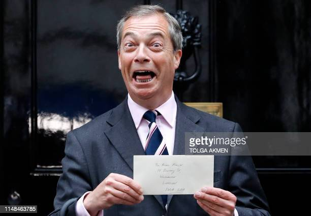 TOPSHOT Brexit Party leader Nigel Farage reacts as he arrives to deliver a letter addressed to Britain's Prime Minister Theresa May outside 10...