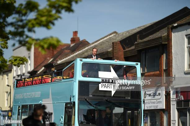 Brexit Party leader Nigel Farage rides on their bus during a visit campaigning for the European Parliament election in Pontefract northwest England...