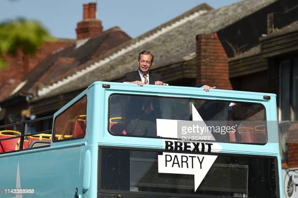 TOPSHOT Brexit Party leader Nigel Farage rides on their bus during a visit campaigning for the European Parliament election in Pontefract northwest...
