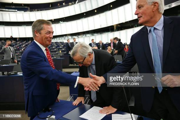 Brexit Party leader Nigel Farage shakes hand with EU's chief Brexit negotiator Michel Barnier in front of European Commission President JeanClaude...