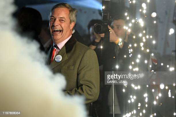 Brexit Party leader Nigel Farage smiles on stage in Parliament Square venue for the Leave Means Leave Brexit Celebration as 11 O'Clock passes in...