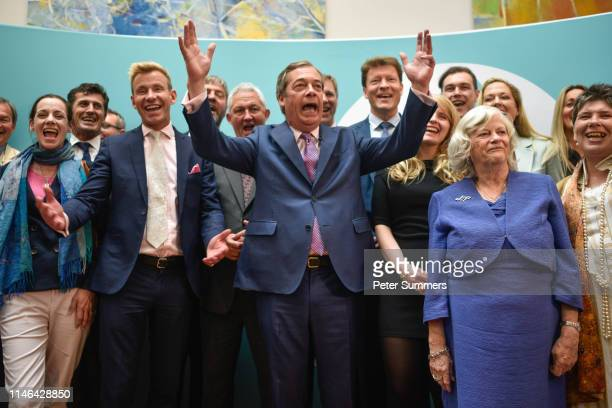 Brexit Party leader Nigel Farage speaks in front of newly elected Brexit Party MEPs including Annunziata ReesMogg Dr David Bull and Ann Widdecombe at...