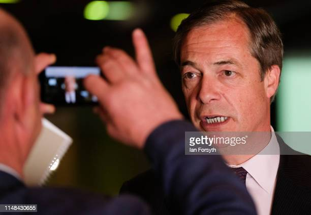 Brexit Party leader Nigel Farage speaks to journalists during a Brexit Party campaign event at Rainton Meadows Arena on May 11 2019 in Houghton Le...
