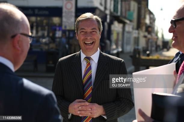 Brexit Party leader Nigel Farage speaks to members of the public during a 'walkabout' campaigning for the European Parliament election in Pontefract...