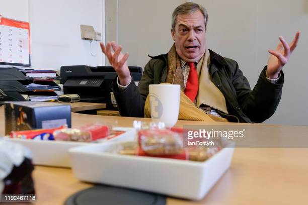 Brexit Party leader Nigel Farage speaks to the management of the Tolley Fabrications factory as he campaigns in Sedgefield on December 07 2019 in...