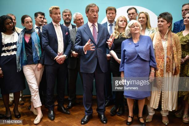 Brexit Party leader Nigel Farage speaks to the media as he stands with newly elected Brexit Party MEPs including Annunziata ReesMogg Dr David Bull...