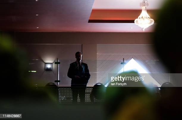 Brexit Party leader Nigel Farage waits to deliver his speech during a Brexit Party campaign at Rainton Meadows Arena on May 11 2019 in Houghton Le...