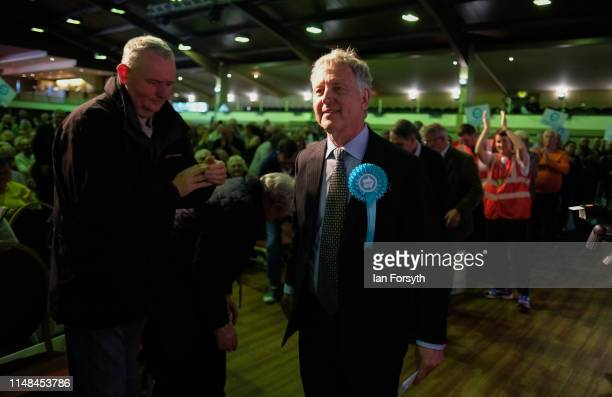 Brexit Party MEP candidate Richard Monaghan is welcomed as he walks to the stage during a Brexit Party campaign event at Rainton Meadows Arena in...