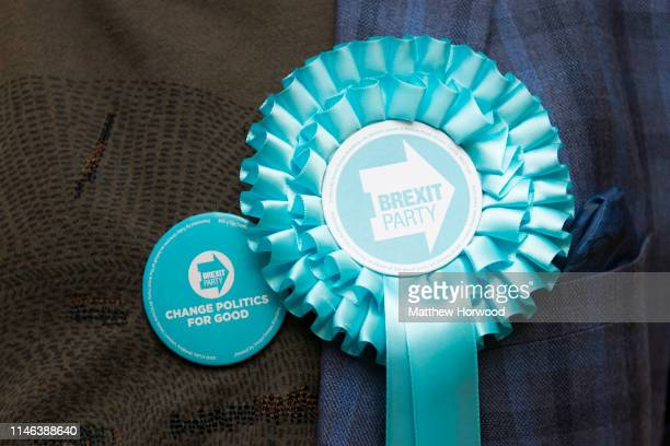 Brexit Party supporter wears a Brexit Party rosette at the Pembrokeshire Archives building in Prendergast on May 26 2019 in Haverfordwest Wales...