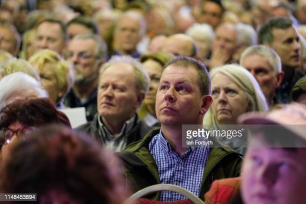 Brexit Party supporters listen to a speech during a campaign event at Rainton Meadows Arena in Houghton Le Spring on May 11 2019 in Durham United...