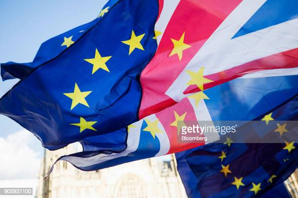 Brexit protesters wave flags made up of a European Union flags and British Union flags otherwise known as a Union Jack outside the Houses of...