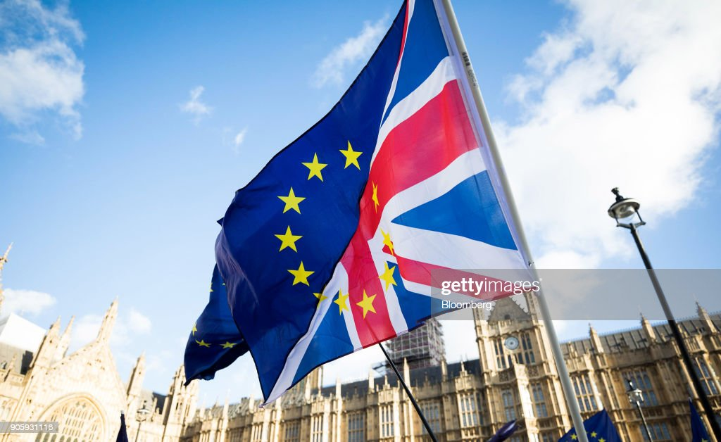 Brexit protesters wave flags made up of a European Union flags and British Union flags, otherwise known as a Union Jack, outside the Houses of Parliament in London, U.K., on Tuesday, Jan. 16, 2018. European Unionleaders kept alive the notion of the U.K. reversing its plan to leave the bloc in a sign of lingering hopes that British Prime MinisterTheresa Maywill halt Brexit scheduled for March 2019. Photographer: Chris Ratcliffe/Bloomberg via Getty Images