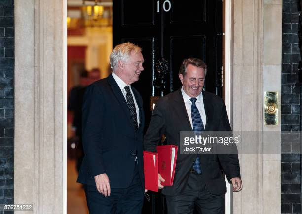 Brexit Secretary David Davis and Secretary of State for International Trade Liam Fox leave following a meeting at Downing Street on November 20 2017...