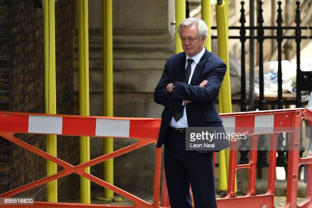 Brexit Secretary David Davis awaits the arrival of DUP leader Arlene Foster at 10 Downing Street on June 13 2017 in London England Discussions...