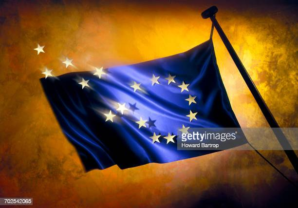 Brexit, stars leaving European flag against golden background