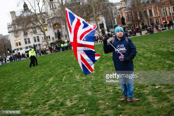 Brexit supporter holds a Union Jack flag in Parliament Square in London, England, on January 31, 2020. Britain's exit from the European Union, today...
