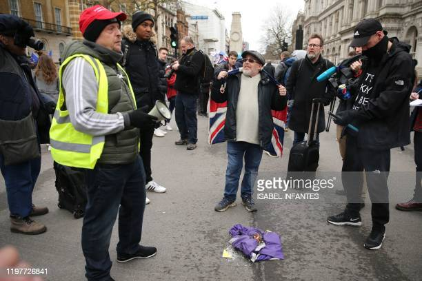 Brexit supporters burn an EU flag in Parliament Square in London on January 31 2020 on the day that the UK formally leaves the European Union Britain...