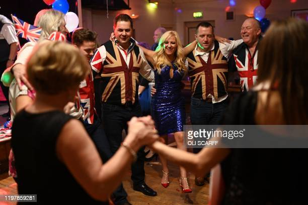 Brexit supporters dance during a Brexit Celebration party at Woolston Social Club in Warrington, north west England on January 31 the day that the UK...