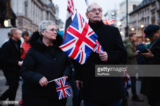 Brexit supporters hold Union Jack flags amid celebrations in Parliament Square in London, England, on January 31, 2020. Britain's exit from the...