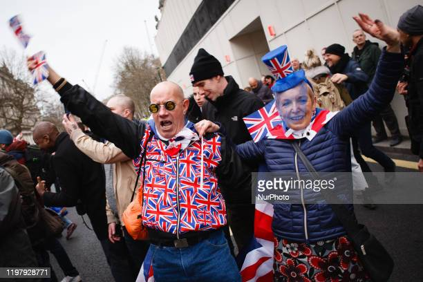 Brexit supporters in Union Jack colours celebrate on Parliament Street in London, England, on January 31, 2020. Britain's exit from the European...