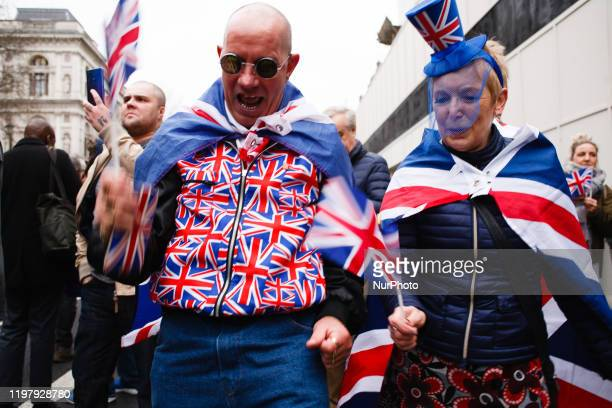 Brexit supporters in Union Jack colours celebrate on Parliament Street in London England on January 31 2020 Britain's exit from the European Union...