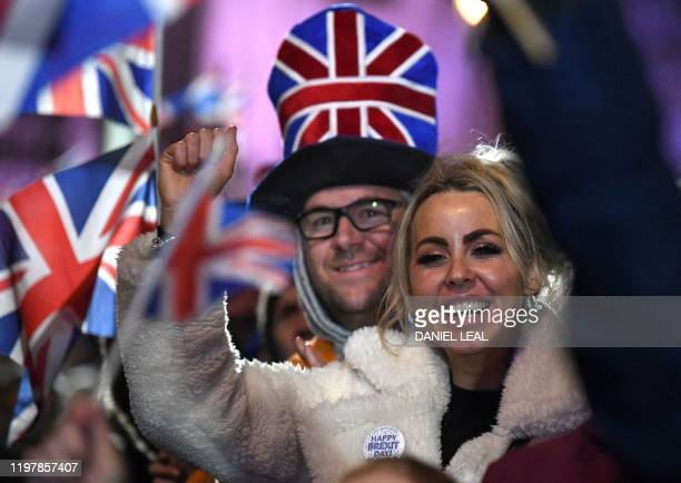 Brexit supporters react during the Leave Means Leave Brexit Celebration in Parliament Square in central London on January 31 the day that the UK...