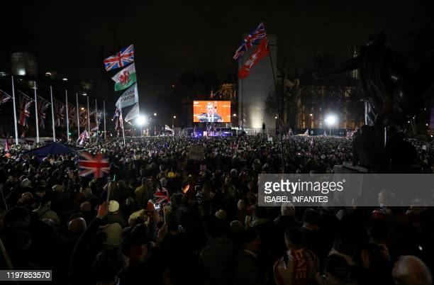 Brexit supporters wait for the festivities to begin in Parliament Square the venue for the Leave Means Leave Brexit Celebration in central London on...