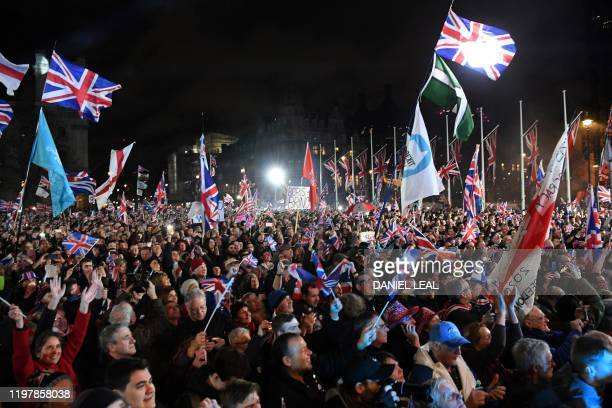 Brexit supporters wave Union flags as the time reaches 11 O'Clock in Parliament Square venue for the Leave Means Leave Brexit Celebration in central...