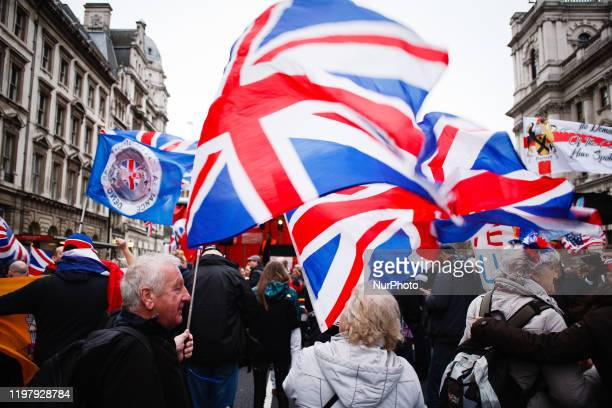Brexit supporters wave Union Jack flags amid celebrations on Parliament Street in London, England, on January 31, 2020. Britain's exit from the...